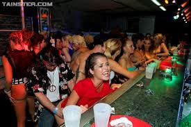 Slutty black and white girls get drunk and fuck in a nightclub.