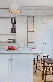 Tall Kitchen Utility Cabinets Provide A Space To Dock Library Ladder Against Side Of Upper