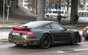A shadowy leaked image of the new porsche 992 911 rear end sent the internet into a fury. Porsche 992 Turbo Breaks Cover Total 911