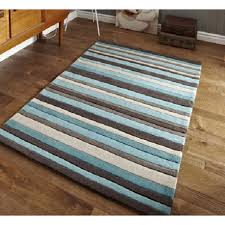 reduced blue brown and beige stripe modern rug