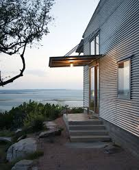 above austin texas based mell lawrence architects designed a low energy galvanized metal guest house that sits on a bluff above a lake