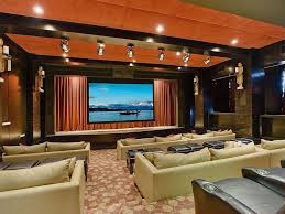 contemporary home theater with concrete floors high ceiling in