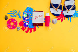 Vibrant Header Header With Traveling Essentials Flat Lay On A Vibrant Yellow