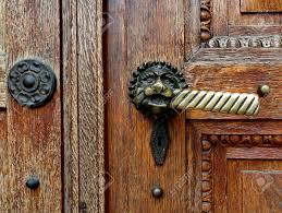 ancient door handle on brown old wooden door stock photo 60611640