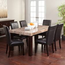 carmine 7 piece dining table set with its creamy caramel colored faux marble top and luxurious faux leather chairs the carmine 7 piece dining table set