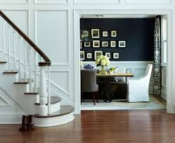 Navy Dining Room with white wainscoting.