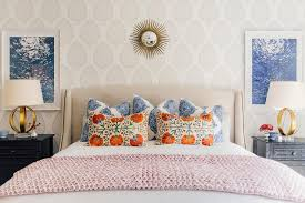 Sophisticated Bedroom Features A Wall Clad In Katie Ridder Leaf Wallpaper  Lined With A Small Gold Sunburst Mirror Place Dover A Linen Nailhead Bed,  ...
