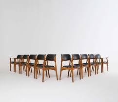 model 50 arm chair in teak and black leather designed by erik buch in 1957