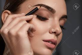 eyebrows makeup beautiful woman with closed eyes perfect make up contouring brows with
