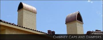 two chimney s with spanish style caps