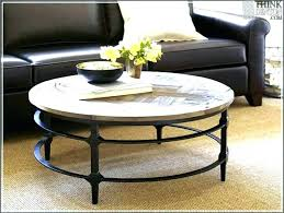 pottery barn coffee table wood legs tanner round with glass top