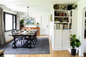 modern dining room with faux wood beams