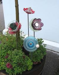 glass flowers garden junk ideas