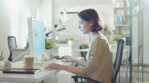 office space computer. Young Beautiful Woman Works Sitting At Her Desk Using Personal Computer. She In A Office Space Computer
