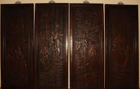 a collection of chinese story telling wooden panels
