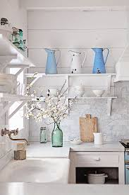 vintage blue pitchers in french country kitchen