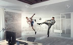 Emotional Businessman Playing Soccer Ball In Modern Office Stock