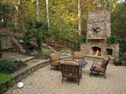 outdoor stone fireplace and stone pathway traditional patio