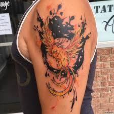 жар птица с черным кругом тату на плече у парня добавлено иван