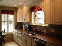 Custom Omega Cabinetry In An Opaque Finish Bumped Out Sink Base And