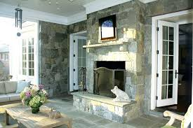 double sided indoor outdoor fireplace the screened porch of tony and home features a double sided