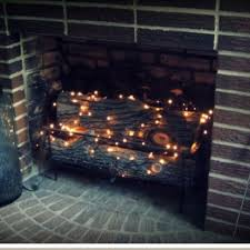 for summer in the fireplace add some mini lights you can even get various size light strand lengths in solar lights so that you don t have to have any ugly