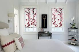 these beautifully design naturally inspired roller shades add a natural touch to this bedroom