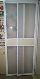 view of door swung open without sliding fully to the middle