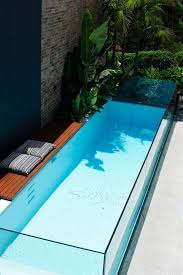 Swimming Pool Design: Natural Narrow Pools With Sunbathing Deck - Swimming  Pool Designs