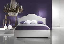 classic bedroom crystal chandelier over white bed frame and purple bedding set match with bedroom wall color
