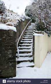 Outdoor Steps A Set Of Outdoor Steps Covered In Snow With A Handrail On The
