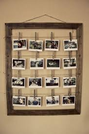 DIY frame with photos 'hanged to dry'. ... could do this