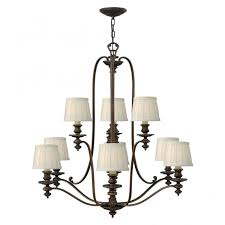 traditional bronze 9lt chandelier with off white pleated shades