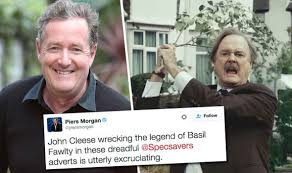john cleese tv adverts piers morgan slams fawlty towers wenn bull specsavers