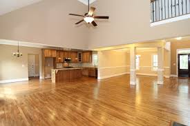 formal dining rooms with columns. the great room opens up with a vaulted two story ceiling. columns divide formal dining room, hallway to master suite tucked between. rooms