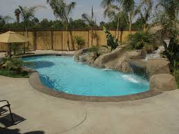 pacific pools and patios freeform pool with slide and rock waterfall pacific pools