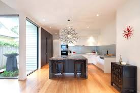 modern branch chandelier tree branch chandelier kitchen contemporary with dark wood wall cabinets image by builders