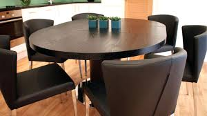 dark wood round dining table black ash extending pedestal base on trendy with cream chairs