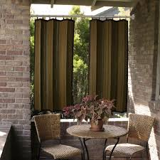 ourdoor terrac area with traditional bamboo curtain panels and stone wall also webbing chairs and webbing