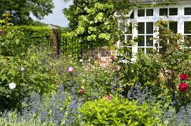 year round flower garden plan border of house with view to gate the garden the coach