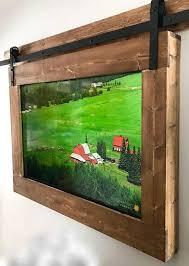 custom wooden tv frame with modern barn