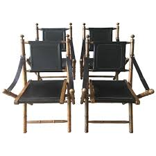 early 1900s english leather and oak folding campaign chairs for