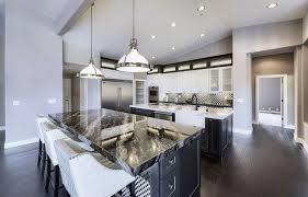 contemporary kitchen with agatha black granite countertops two islands white cabinets and blackened hickory