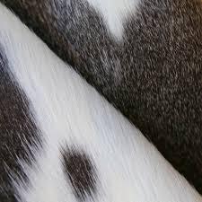 white cowhide rug grey