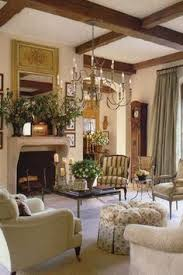 country living room ci allure: traditional living room with french doors chandelier exposed beam carpet franklin builder