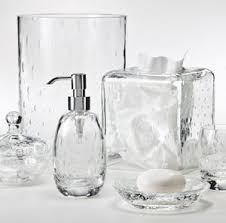 clear glass bathroom accessories. bubbles suspended within clear glass add a touch of whimsy to this design. the appear randomly as is blown, making each piece unique. bathroom accessories o