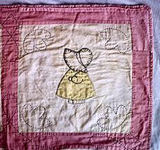 Quilt Repair by Ann Wasserman & sunbonnet sue before, sunbonnet sue after Adamdwight.com