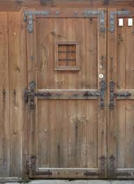 wood door texture. Wooden Door In Dark Tone With Metal Accents And Small Window Center. Wood Texture