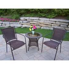 stackable resin patio chairs. Oakland Living Corporation Merit Resin Wicker Stackable Chairs And Side Table Set Patio