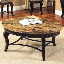 charming round natural brown granite top coffee table with four black wooden legs on ivory rug